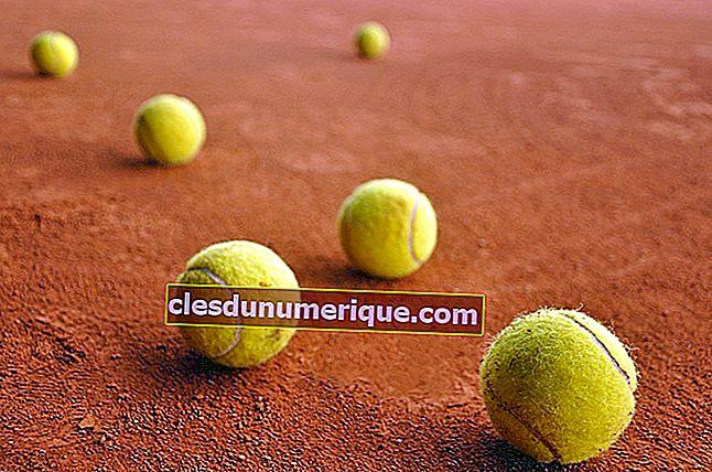 Razones para que una pelota de tenis sea amarilla y áspera o peluda